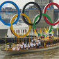 Olympic Games London 2012: Olympic Rings on River Thames with Torch