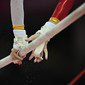Olympic Games London 2012: detail hands on uneven bars