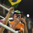 Olympic Games Rio 2016: FIG-Gala, fan with two mobiles